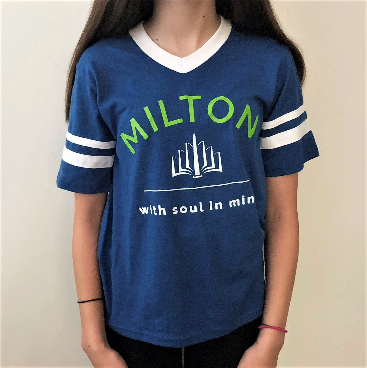 A bright blue short sleeved T-shirt with white stripes on the sleeves and the MILTON logo large in the center of the shirt.